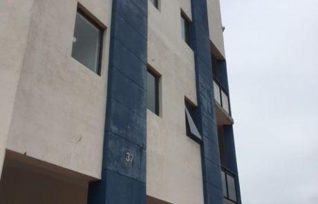 Apartment block needing repaint